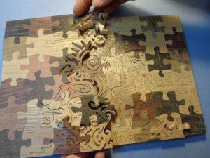 Puzzle² fustellato, intarsiato e intarsiato da Cesare Rocchi